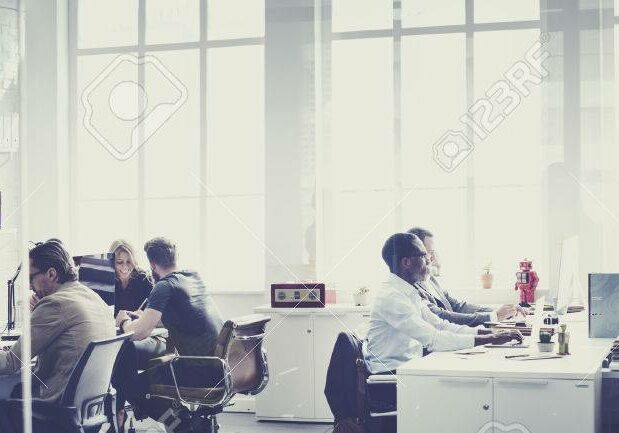 53103303-business-team-busy-talking-workplace-concept